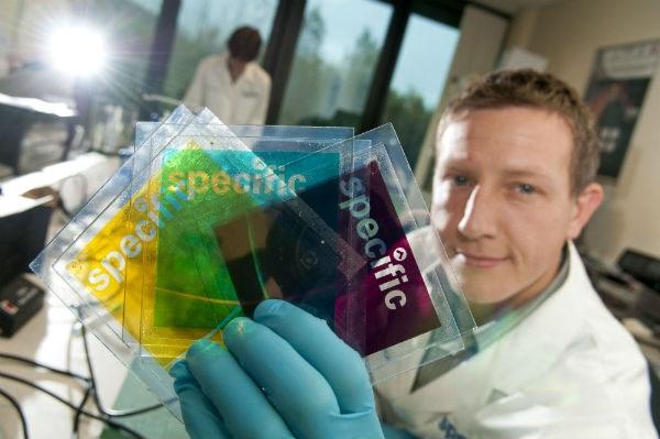 Dr Matthew Davies showing printed perovskite photovoltaics solar cells